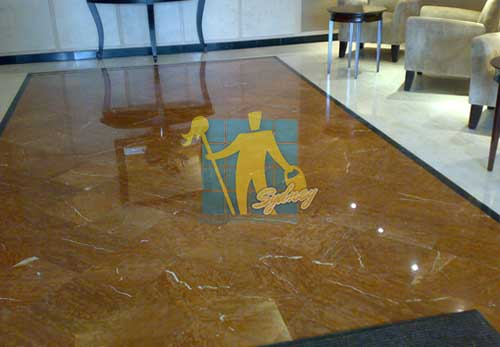 cleaning sealing and polishing brown granite floor rounded with limestone