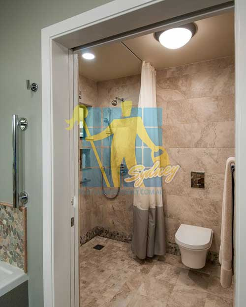 Contemporary Master Bathroom with flush light and yellow Polished Limestone Slab and Rain shower
