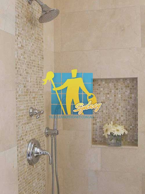 shower with limestone walls