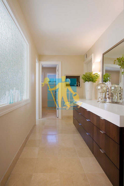 modern long bathroom with porcelain tiles that look like fake travertine